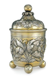 POSSIBLY WOLFGANG JUN II GERMAN PARCEL-GILT SILVER BEAKER AND COVER, cylindrical, chased with flowering plants above three ball feet, gilt interior, Augsburg, 1659-63