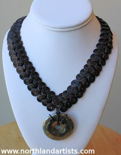 Handmade antiqued copper Egyptian coil necklace with pyrite disk pendant by Susan Pauls.