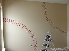 This is so simple, yet perfect! We could paint the other walls navy blue and then just paint this wall like a baseball I love it!