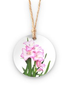 Pink Iris Ornament: What a beautiful product! An artistic addition to holiday decor, our ornaments are memorable gifts they'll want to display long after the holiday season. Limited edition. Available in metal and bamboo.