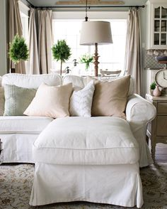 love this beautiful living room with soothing neutrals and green plants