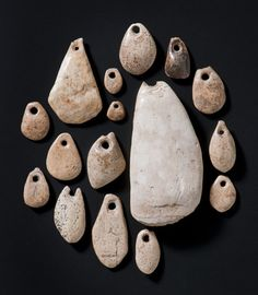 Pendants made of mammoth ivory, Stone age, 23.000 B.C. Found in the cave Brillenhöhle in the South of Germany. The drop-shaped pearls are characterized by their color and the tactile appeal of ivory. Landesmuseum Württemberg, Stuttgart 📷 Zwietasch.