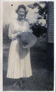 Original vintage/antique black and white snapshot photo..a pretty young woman holding her hat..1910s  ** 2 3/4 x 4 3/8   I have a passion for vintage photographs, snapshots, vernacular and found photos and paper ephemera. Its a way of preserving and connecting with the past.  Old photos can be used for interior wall hangings, altered art and mixed media projects, for greeting cards and for collecting. Vintage photos are a snapshot moment in time and each one tells its own stor...