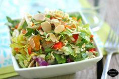 Chinese Chicken Chop Salad (Chopped Romaine, Shredded Cabbage and Purple Cabbage, Shredded Carrot, Chopped Red Bell Pepper, Green Onions, Chopped Parsley, Bean Sprouts, Diced Grilled Chicken, Mandarin Oranges, Toasted Sliced Almonds, Toasted Broken Up Ramen, Newman's Garlic Ginger Dressing)