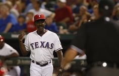 CrowdCam Hot Shot: Texas Rangers manager Ron Washington talks to home plate umpire Rob Drake during the eighth inning of the game against the Oakland Athletics at Rangers Ballpark in Arlington. The Oakland Athletics beat the Texas Rangers 9-8. Photo by Tim Heitman