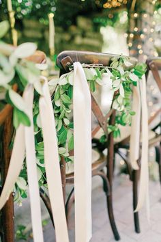 Summer Soirees - Orlando Magazine - June 2014 - Orlando, FL  Decorating the chairs with ivy and ribbon is a picturesque touch, and a great alternative to the traditional chair sash.  Andi Mans Photography