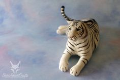 Needle felted miniature tiger by SaniAmaniCrafts