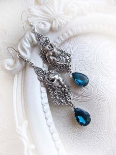 Angel tears  cherub earrings with blue crystal  by MidnightVision