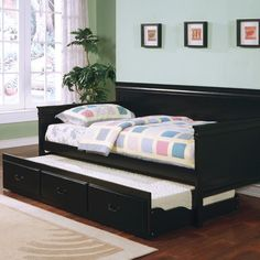Oswald Daybed with Trundle Finish: Black - https://delanico.com/daybeds/oswald-daybed-with-trundle-finish-black-683694154/
