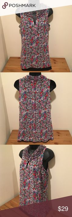 """Cabi sleeveless blouse career work wear Cabi sleeveless blouse in a beautiful floral pattern. Detailed neckline, elasticized gathering at the back to slightly accentuate the waist. Measurements: bust 18"""" length 28"""" 100% polyester. In excellent used condition. Smoke-free home. Save 15% by bundling. CAbi Tops Blouses"""