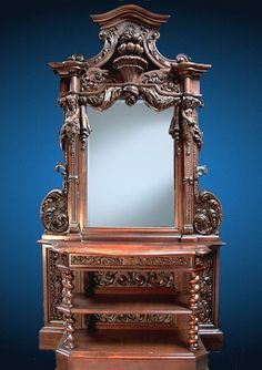 Elaborate Carved 19th Century Walnut Venitian Renaissance Cabinet with flanking man and woman and tree dimensional fruit
