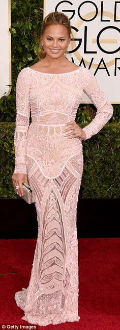 Gorgeous: Sports Illustrated cover girl Chrissy Teigen looked elegant in a beaded Zuhair Murad pale pink dress that featured an elaborate pattern over nude mesh lining