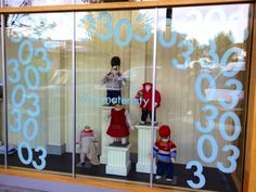 Visual Merchandising + Window Displays by Kelsey Eads. Village Maternity 30th Anniversary, Children's Clothing Display.