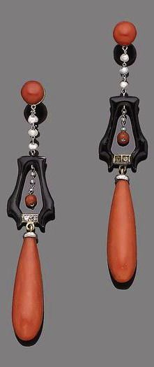 A pair of art deco coral, seed pearl, enamel and diamond pendent earrings, circa 1925 Each circular cabochon coral corallium rubrum, suspending articulated seed pearls, black enamel and rose-cut diamond columns, surmounting a coral drop, length 6.5cm
