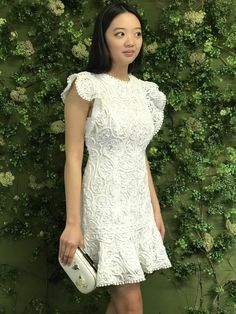 Be chic and cool in this short white ruffle sleeve dress! The lace detail is so pretty right?   #chloedao #chloedaoboutique #littlewhitedress #shortlacedress #springfashion2019 #summerfashion2019 #rufflesleeve #bridaldress #summerstyle #houstonfashion #fashionphotography #boutiquestyle #houstontexas