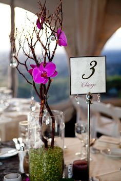Bright purple orchid wedding table centerpiece, photo by La Vie Photography