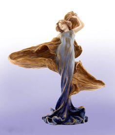 "An Art Nouveau pottery ""Loie Fuller"" lamp, Amphora Bohemia circa 1905."