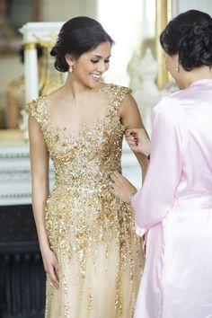 Glamorous gold + sparkly wedding dress:  http://www.stylemepretty.com/little-black-book-blog/2016/01/04/french-chateau-wedding-sparkly-gold-dress/   Photography: Lauren Michelle - http://laurenmichelle.com.au/