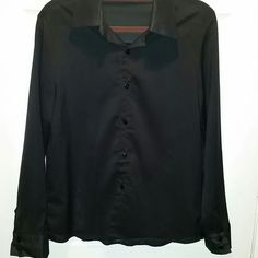 Black sheer button up blouse small Black sheer button up blouse purchased at a boutique so it runs small. The size states large, but it will fit a small (at most a size 6). Looks great with jeans, skirts, trousers, etc. Versatile. boutique Tops Button Down Shirts