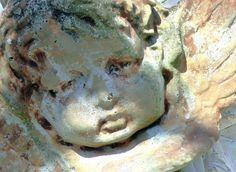 love the layers of colors on this stone cherub