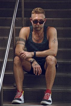 Transformative Effect.  How to Wear Man Jewelry, featuring Philip Crangi on The Style Blogger.  Tank top by Dries Van Notten. Shorts by Kolor. High tops by Gola. Timepiece by Swatch. Vintage Wayfarer II shades by Ray-Ban.