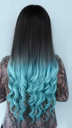 Long hair don't care!! What is not to love?! Her light blue tips and romantic curls is the perfect look  #bluehair #ombre
