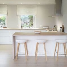 I simply adore this Norwegian home's breakfast bar, modern white kitchen with light wood worktop and flooring and living space. Very Scandi chic with white walls, minimalist style and white stools perfect interior inspiration for kitchen ideas Ikea Kitchen Design, Home Decor Kitchen, Interior Design Kitchen, Kitchen Furniture, Home Kitchens, Kitchen Ideas, Ikea Furniture, Open Plan Kitchen, New Kitchen