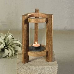 Millwood Pines Made of natural mango wood, this Wood Hurricane conveys an architectural and organic essence. A removable glass hurricane nestles inside to ensure a steady flame when placed outdoors, pair with our essential tealights.