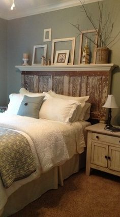 Love the headboard with the mantel/shelf overhang ~ shelf over the bed in California is probably not a good idea, but I still love the look!  :o)