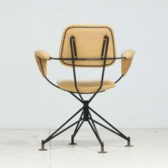 Gastone Rinaldi; Enameled Metal, Brass and Leather Armchair for Rima, 1950s.