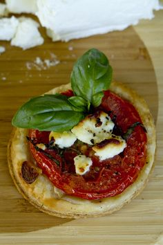 Mini Tomato & Goat Cheese Tarts ~ The sweetness of the tomatoes and goat cheese compliment the buttery puff pastry so well... savory appetizers!