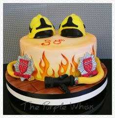 Www.thepurplewhisk.co.uk  Firefighters cake. Carrot cake with hose, helmets and badges.