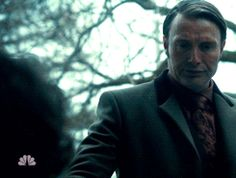 Look at Hannibal's hand. It's in the darkness when he hold out to Will.But Will's hand is in the light.Until he takes his hand.