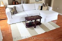 DIY area rug by sewing together table runners. Much cheaper than buying an area rug.