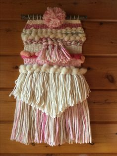 Pink and cream with pompom