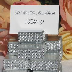 Silver Wedding Place Card Holder trimmed with a rhinestone wrap