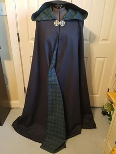 New - Fully lined Cloak with Hood Cleburne, TX $200  New, fully lined cloak with hood. The outside is dark blue fabric that can be water proofed. The lining (which is turned with no seams) is blue and green plaid. To finish this awesome cloak is a Celtic pewter clasp. This cloak is quality through and through and one of a kind.