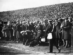 1930 A woman who has fainted receives medical attention on the pitch sidelines during the FA Cup Semi-Final between Sheffield Wednesday and Huddersfield Town at Old Trafford