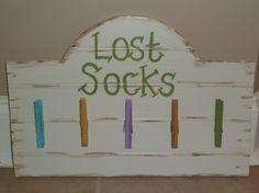 Laundry Room Missing Sock Sign by DesignsByJackieByrd on Etsy, $14.99