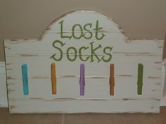 Laundry Room Missing Sock Sign by DesignsByJackieByrd on Etsy, $14.99