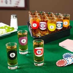 Dont scratch when taking shots at your next party. Whether youre solids or stripes, our Rack Em Up billiards shot glass set is the best way to cue up your drinks for yourself and all of your buddies. Featuring 1 through 10 billiards balls, these shot glas Pool Table Room, Pool Tables, Billard Snooker, Pool Party Games, Shot Glass Set, Bar Games, Rack, My Pool, Billiard Room