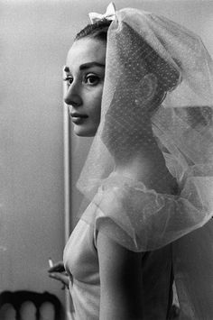 Audrey Hepburn on the set of Funny Face (1956, photo by David Seymour) (via)