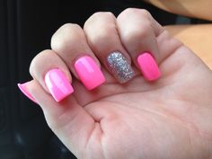 Neon pink nails with silver sparkly ring finger