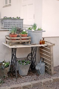 Love this potting table idea but I esp. LOVE the wooden tray leaning next to it