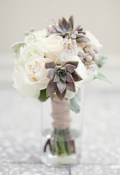 love the subtle colors in this succulent and rose wedding bouquet
