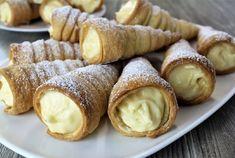Conuri umplute cu cremă. O rețetă de desert delicios foarte ușor de făcut. Conurile fragede formează un duet minunat cu crema fiartă atât de gustoasă și aromată. INGREDIENTE: Pentru aluat: -500 gr de făină; -250 gr de unt; -250 gr de smântână fermentată; -1/2 linguriță de sare. Pentru cremă: -5 gălbenușuri; -200 gr de zahăr; -90 gr de amidon; -500 ml de lapte; -8 gr de zahăr vanilat; -200 gr de smântână fermentată 30%. MOD DE PREPARARE: 1.Pregătiți aluatul. Amestecați făina cu sare. Apoi… Christmas Sweets, Food Cakes, Cookie Recipes, Food And Drink, Bread, Candy, Homemade, Cookies, Healthy