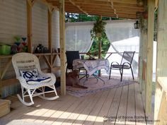 10 x 20 mobile home porch is welcoming and quite charming. Notice the outdoor curtains, rug and lantern collection! front-porch-ideas-and-more.com