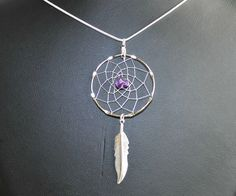 Large Silver Dreamcatcher Necklace with Amethyst and feather, Native Americana, Amethyst Necklace, tribal, boho by OriginalsByCathy on Etsy https://www.etsy.com/listing/252971849/large-silver-dreamcatcher-necklace-with