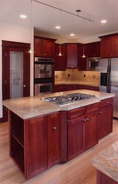 Kitchen Island With Stove And Lovely Counter - plan #071D-0003 | houseplansandmore.com