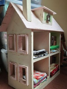 Old dollhouse to store fabric @ the lost apron